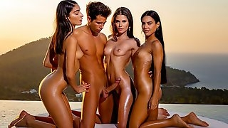 Three beautiful brunettes at sunset gave the boy group Orgy...