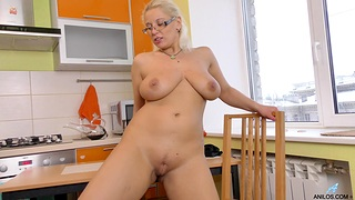 Randy blonde slut Luba Luve loves fingering her cunt in the kitchen